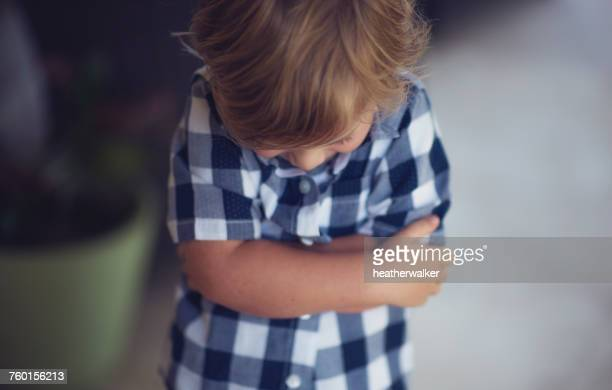 boy standing with arms crossed - sulking stock pictures, royalty-free photos & images