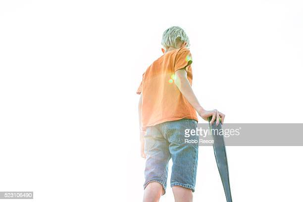 boy (10-12) standing with baseball bat - robb reece stock pictures, royalty-free photos & images