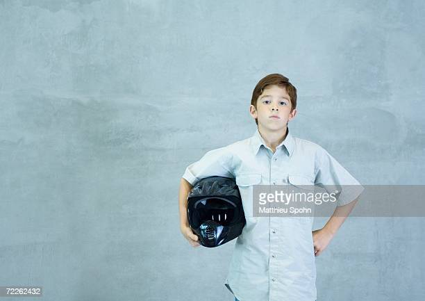 boy standing with helmet under arm - will power race car driver stock pictures, royalty-free photos & images