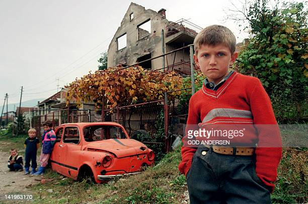 A boy stands 17 November 1995 next to his destroyed house in the BosnianMuslim enclave of Gorazde in eastern Serbheld Bosnia
