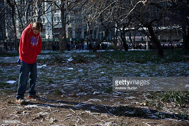 A boy stands among ticker tape during The New York Giants' Victory Ceremony at City Hall in downtown New York on February 7 2012 2012 in New York...