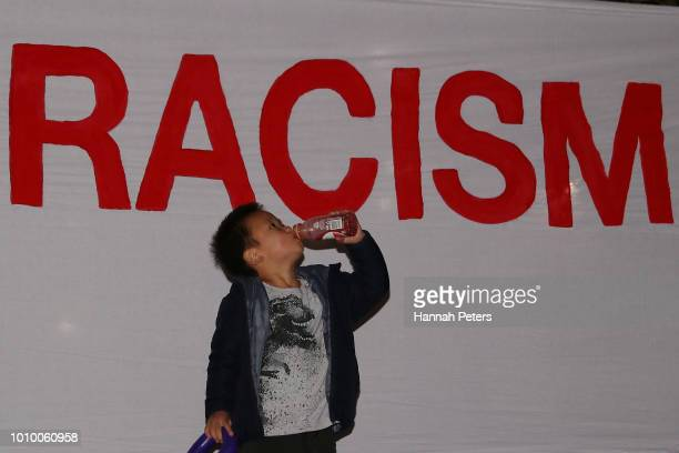 A boy stands in front of a anti racism banner at Aotea Square on August 3 2018 in Auckland New Zealand Ten activist groups have joined together for...
