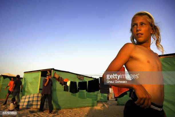 A boy stands in front of a tent in the newly build tent city on July 27 2005 in Shirat Hyam Gaza Strip The tents were built to host nonresidents...