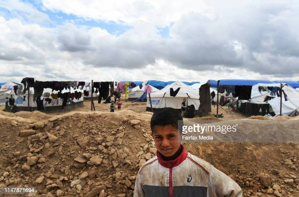 A boy stands in front of the foreign section of the alHawl refugee camp in northern Syria close to the SyriaIraq border April 2 2019 The camp is home...
