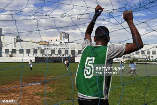 A boy stands in the goal as he trains as a goalkeeper at Sao Cristovao football club in Rio de Janeiro Brazil on February 7 2018 Tiny Sao Cristovao...