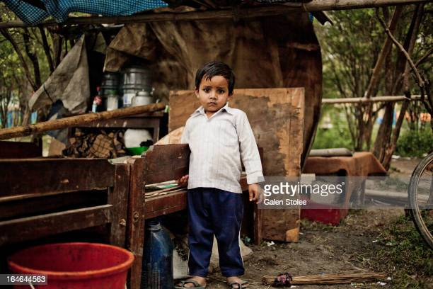 CONTENT] A boy stands next to his makeshift home in the Thapathali slums which were recently demolished by the Nepalese government In an effort to...