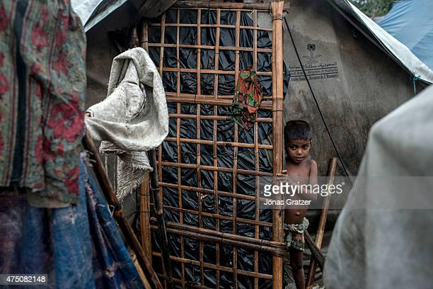 Boy stands outside his hut in one of the unregistered IDP camps, May 24, 2015 in Sittwe, Burma. Since 2012, the minority group of the Rohingya people...