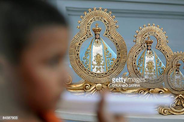 Boy stands outside the sanctuary of the Virgin of Suyapa --patron saint of Honduras-- during preparations in the eve of her name day, on February 2,...