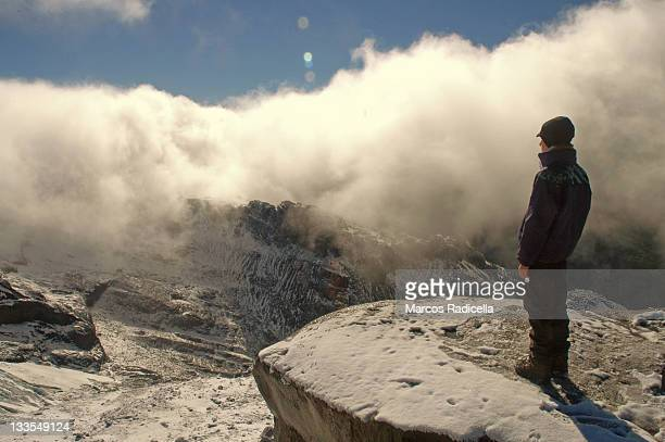 boy staring at mountain view, patagonia - radicella imagens e fotografias de stock
