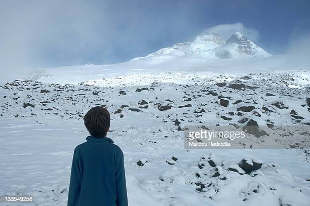 boy staring at tronador mount, patagonia argentina - radicella stock photos and pictures