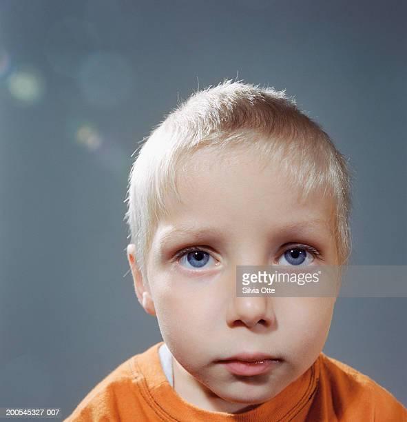 Boy (4-5) staring, close-up