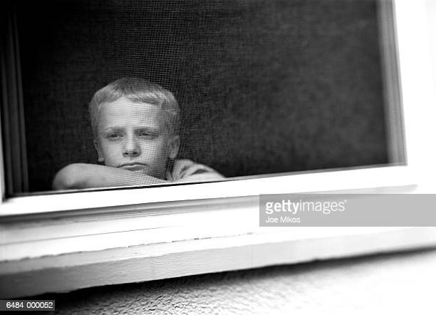 Boy Staring out of Window