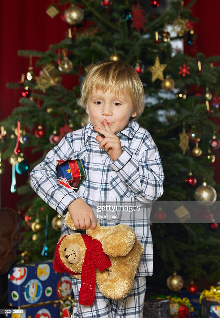 boy stealing christmas present stock photo - Stealing Christmas