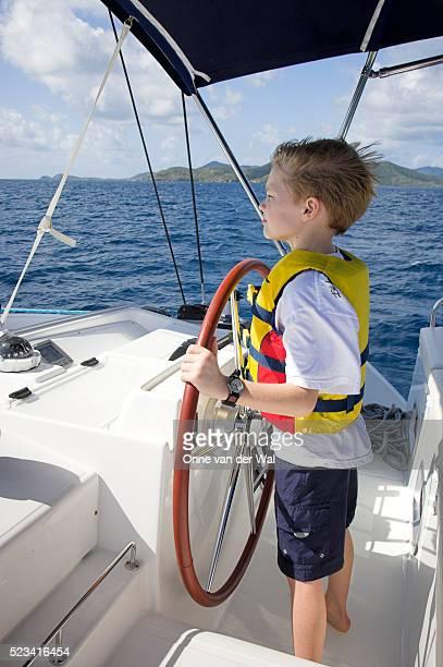 Boy Steering Catamaran
