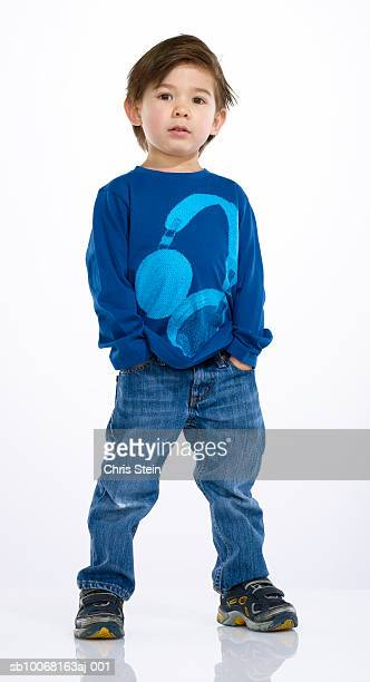 boy (2-3), studio portrait - hands in pockets stock pictures, royalty-free photos & images