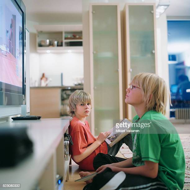 boy studying and playing video games - television show stock pictures, royalty-free photos & images