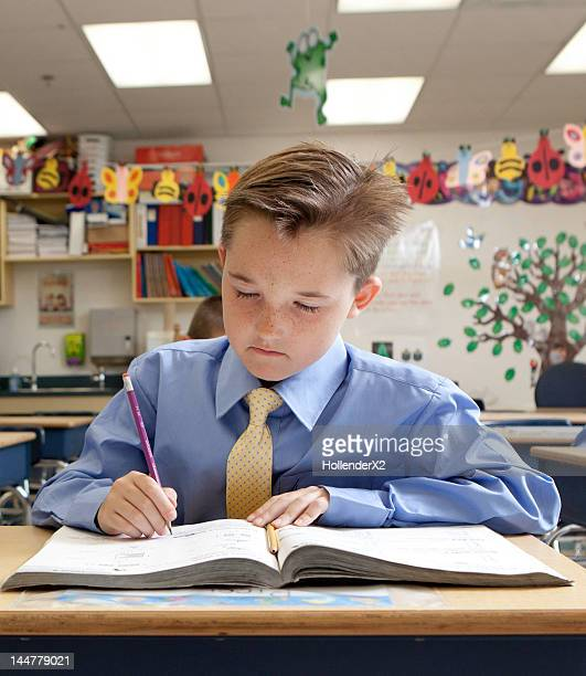 boy studying in classroom - newtechnology stock pictures, royalty-free photos & images