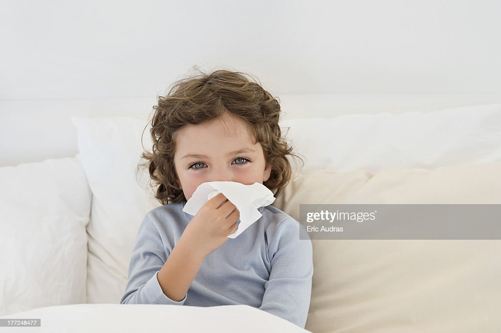 Boy suffering from cold : Stock Photo