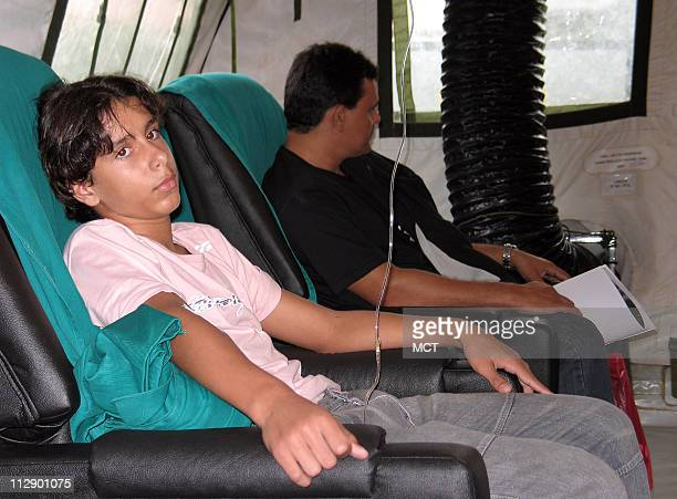 A boy suffering from dengue fever receives hydration treatment April 8 in Rio de Janeiro Brazil at an air force firstaid camp set up to fight a...