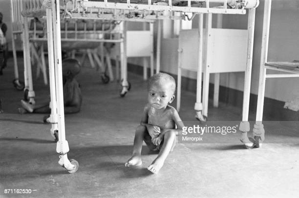 Boy suffering from malnutrition hides under his cot during an air raid at Queen Elizabeth Hospital Umuahia just one of the estimated one to two...
