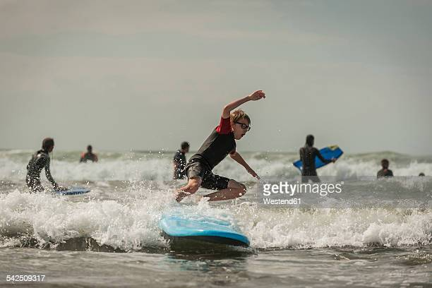 Boy surfboarding