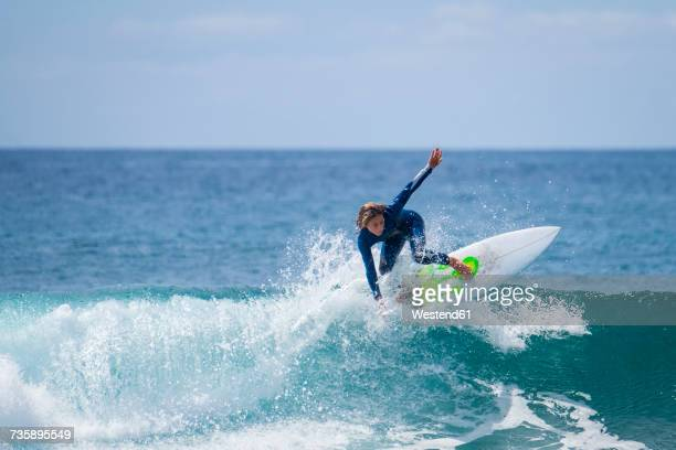 boy surfing in the sea - atlantic islands stock pictures, royalty-free photos & images