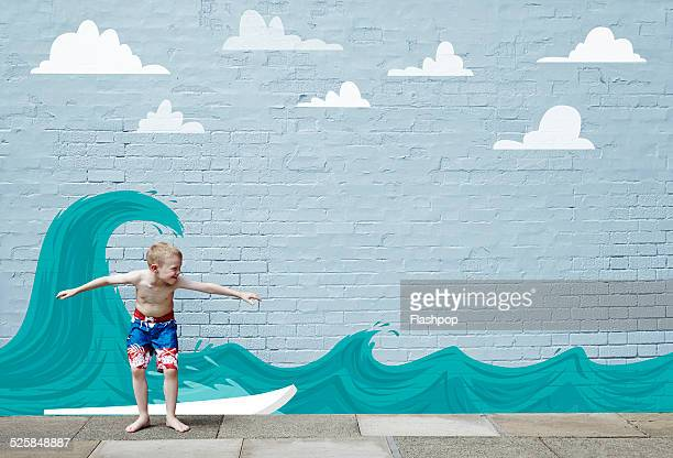 Boy surfing on cartoon wave