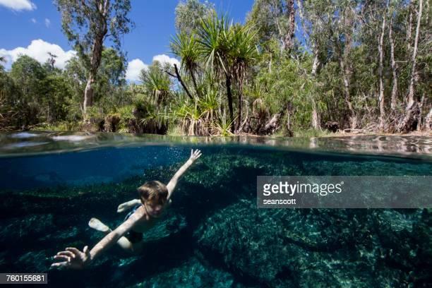 Boy swimming in a natural spring, Western Australia, Australia
