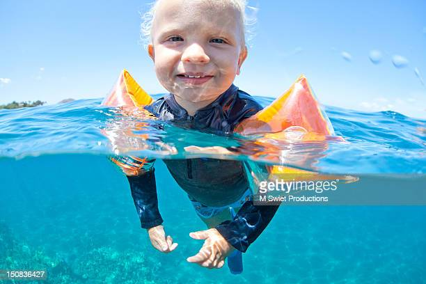 boy swimming in ocean - airbag stock photos and pictures