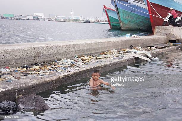 A boy swimming in the sewage around the old Jakarta sea wall in Jakarta Indonesia on October 11 2016 Government with developers would built the new...