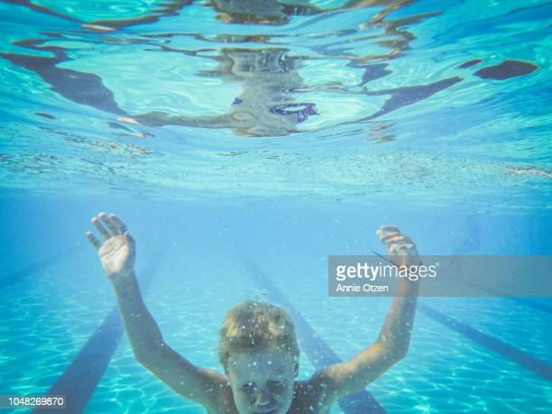 Boy Swims to the bottom of a pool