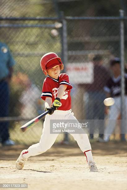 boy (10-12) swinging baseball bat at ball (blurred motion) - batting sports activity stock photos and pictures