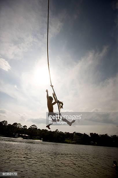 Boy swinging on ropeswing