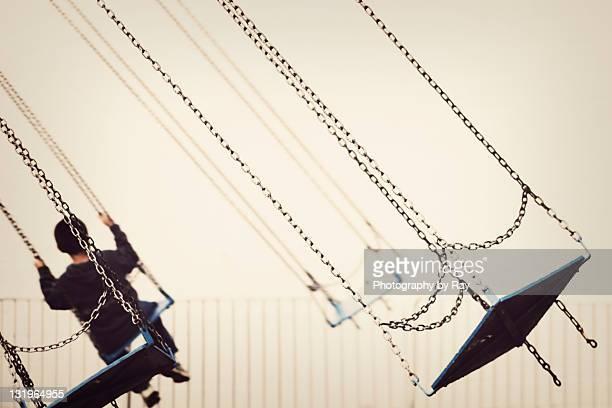 Boy swings
