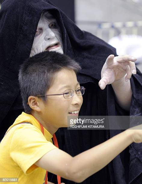 Boy takes a picture with Palpatine during the Star Wars Celebration Japan, a exhibition to celebrate the 30th anniversary of the Star Wars movies at...