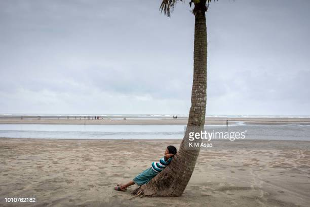 A boy takes a rest at cox's bazar beach area in Coxs Bazar