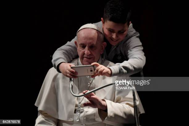 A boy takes a selfie photo with Pope Francis at the church of St Maria Josefa in Castelverde on the outskirts of Rome during a pastoral visit on...