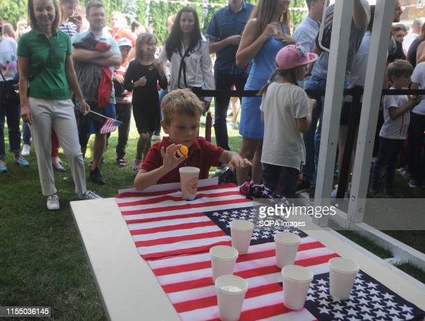A boy takes part in one of the games during the US Independence Day celebration at the American House in Kiev