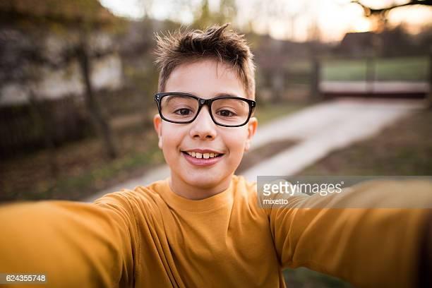 Boy takes selfie