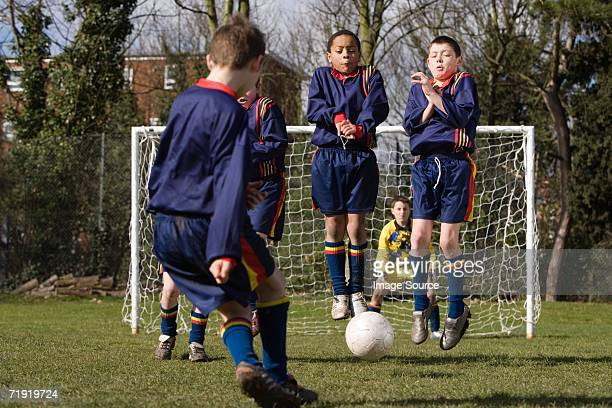 boy taking a free kick - defending stock pictures, royalty-free photos & images