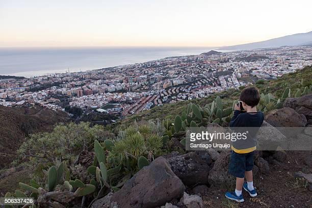 Boy taking a picture of Santa Cruz de Tenerife