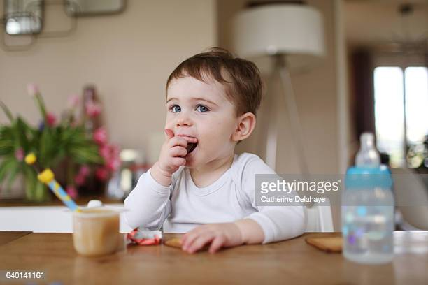 A boy taking a snack at home