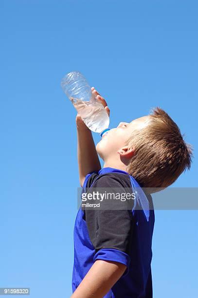 Boy taking a thirsty drink