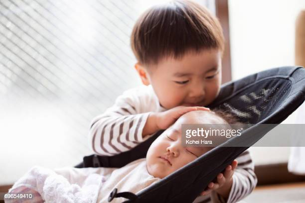 Boy taking care of baby