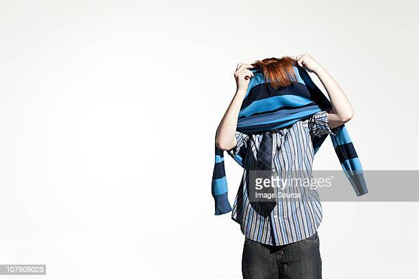 boy taking off his sweater - clothes on clothes off photos stock pictures, royalty-free photos & images