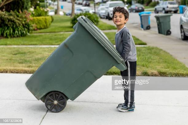 boy taking out trash - absence stock pictures, royalty-free photos & images