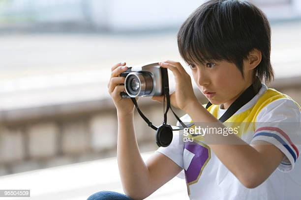 Boy taking picture at platform