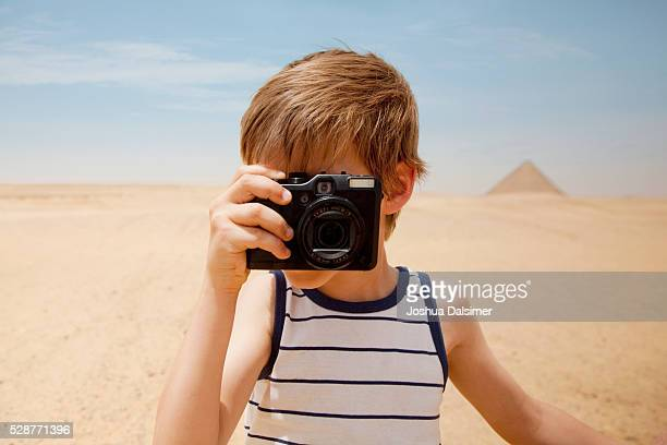 Boy taking pictures in the desert