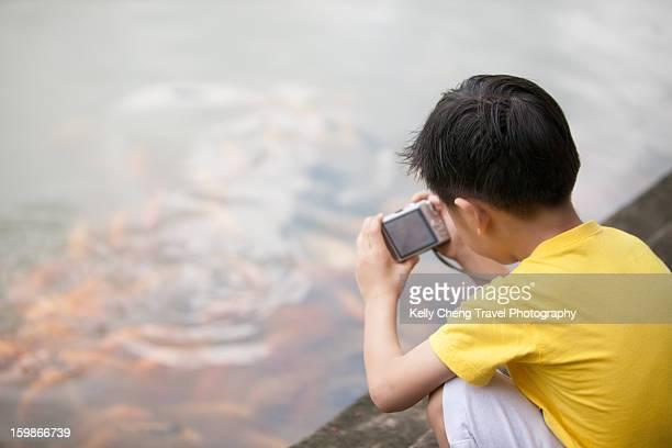 boy taking pictures - 透けて見える ストックフォトと画像