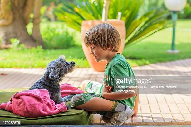 Boy talking with dog